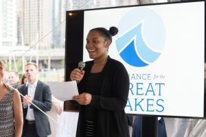 Devona addresses guests at the Great Blue Benefit