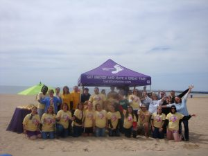 Volunteers celebrate clean beaches at a Barefoot Wine & Bubbly Adopt-a-Beach event.