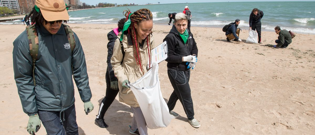 Adopt-a-Beach volunteers pick up litter from a beach in Chicago