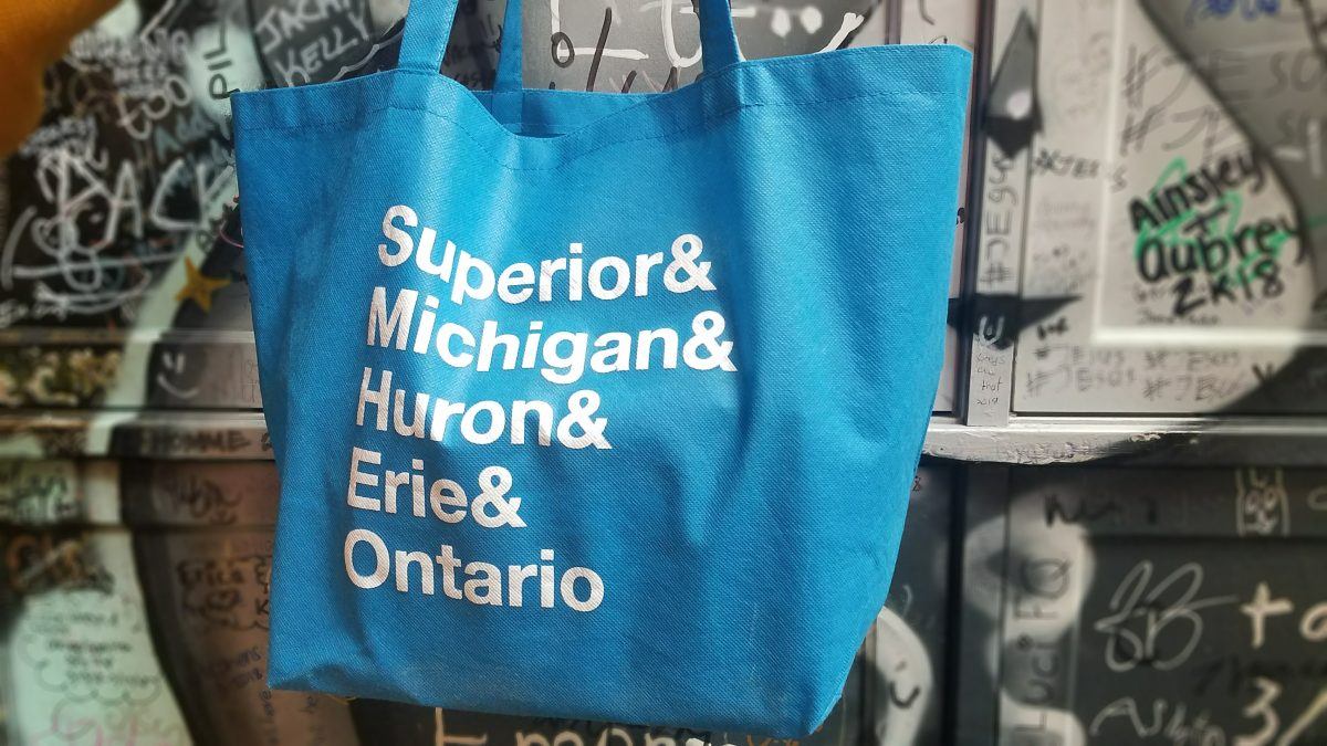 Blue bag with white text listing the names of the Great Lakes