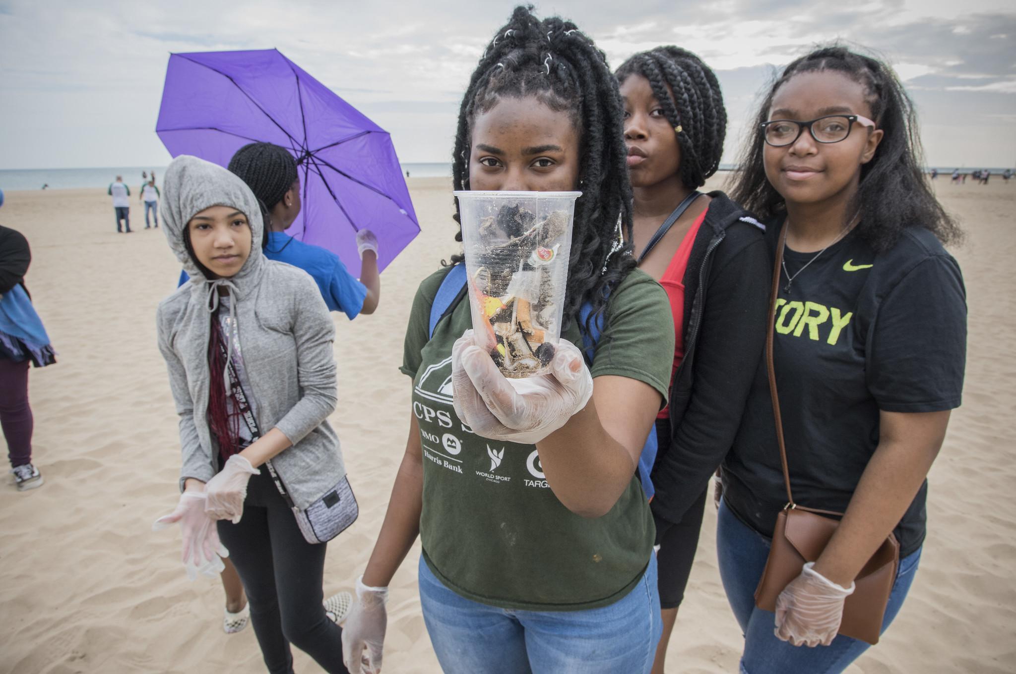 Senn High School students hold trash