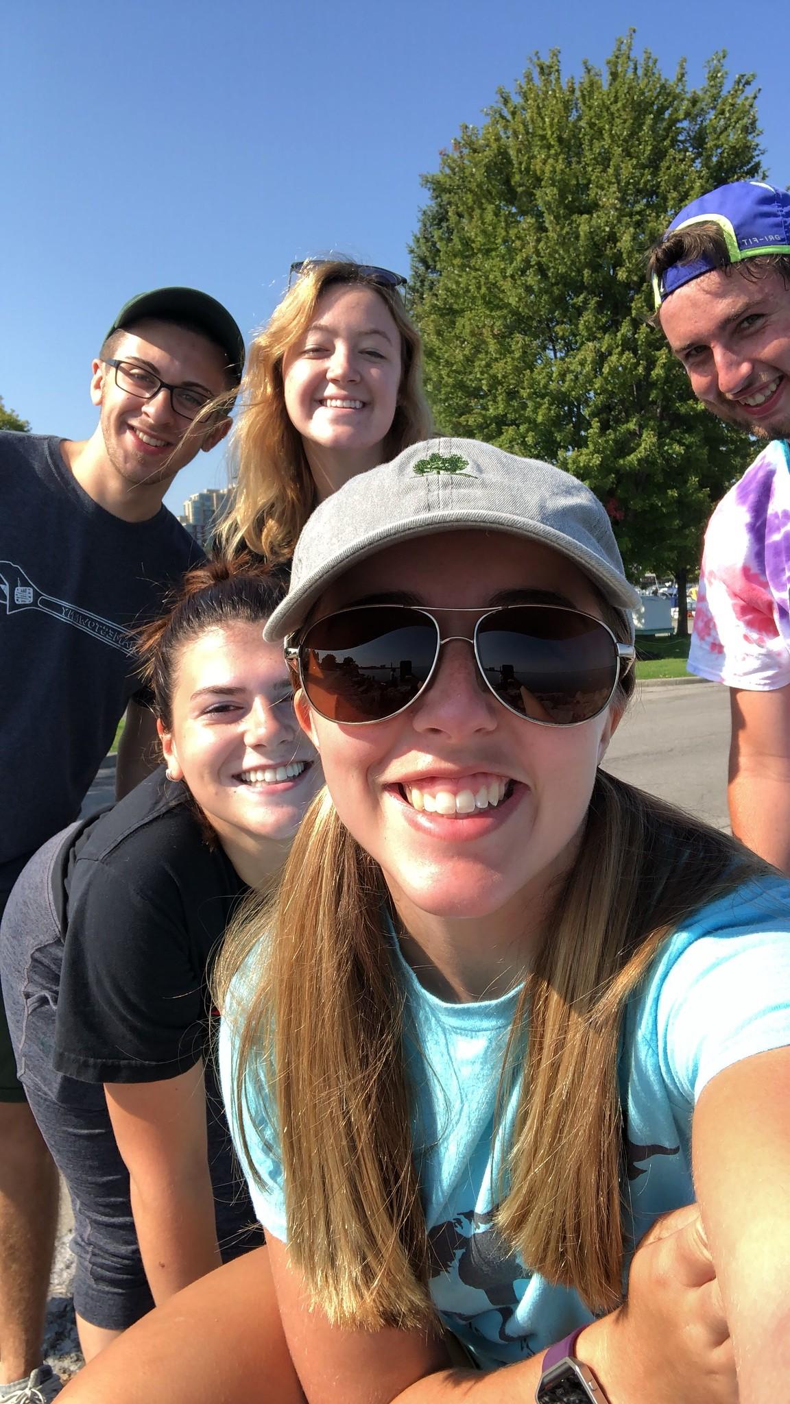 Group of young volunteers take selfie