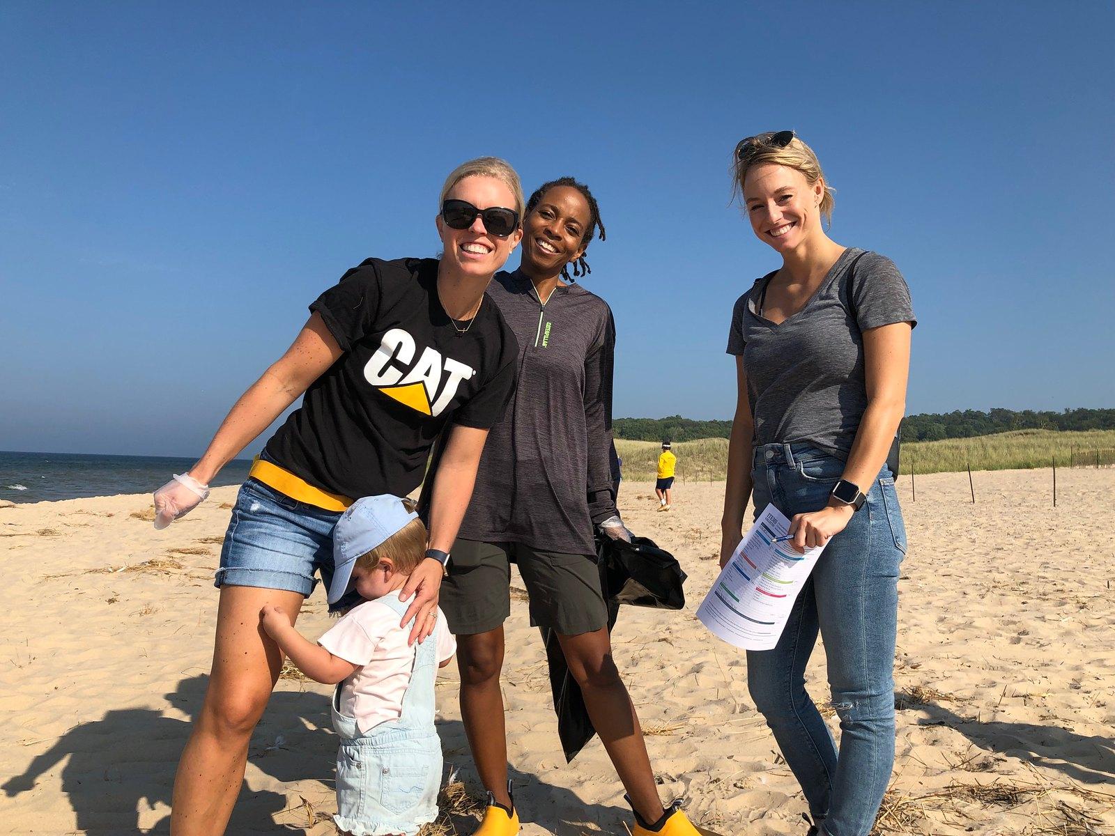 Four Cat Footwear volunteers on beach