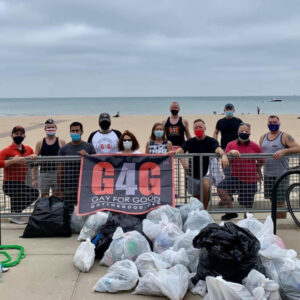 Adopt-a-Beach volunteers pose with trash they removed