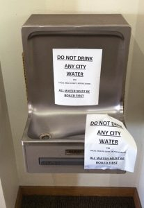 "Photo of drinking fountain with ""Do Not Drink Any City Water"" sign"